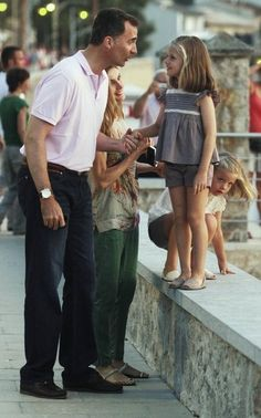 Spain's Crown Prince Felipe, Princess Letizia and their daughters Infantas Leonor and Sofia pause as they go for a walk in Port de Soller, on the Spain's Balearic island of Mallorca, August 6, 2012.