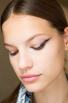"""Karim Rahman created a smudged black """"feline"""" eye at Lanvin, using black cream pigment on the bend of a straw at the outer corners of the eyes."""