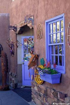 A colorful store front on Santa Fe's downtown Plaza, New Mexico. Santa Fe has a great design presence. Santa Fe Style, Deco Boheme, Land Of Enchantment, Southwest Style, Southwest Decor, Le Far West, New Mexico, Mexico Style, Windows And Doors