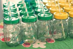 """DIY Mason jar spray-painted """"sippy cups"""": drill hole in lid, smooth with metal file, spraypaint to match party colors {or plain white / silver / gold}"""