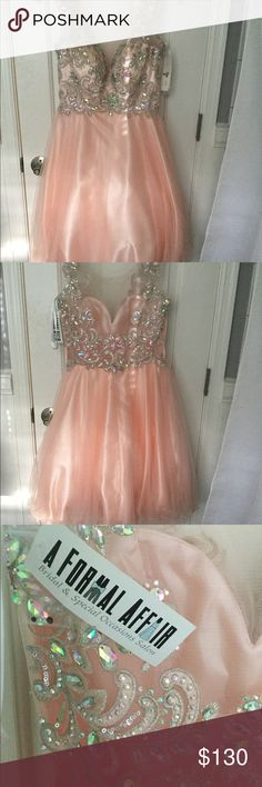 Beautiful Formal Dress Size XS, NWT. Absolutely gorgeous dress from A Formal Affair.  It's a peach pink color with beautiful rhinestone detail.  It's has a tulle flowy bottom.  Beautiful! Dresses Prom