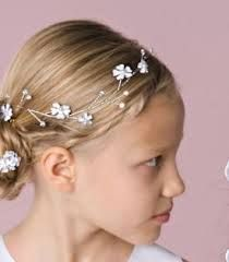 Low bun with flower hair accessory
