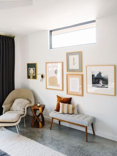 Art Collage Wall and Reading Nook in this Mid Century Modern Bedroom Design with Wool Cream Rug, Parachute Quilt Bedding and Walnut Bedframe and Nightstands. Black Lamps, Roman Shades and Custom Beaded Art above Headboard