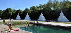 Natuur als attractie: EcHologia, een vakantiepark met mooie natuur, duurzame accommodaties en een blue lagoon om in te duiken.