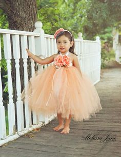 Peach Devine Tutu Dress made with over 200 yards of shimmer best quality tulle material, that is made in the USA. This is a beautiful peach color tutu, that has attached a peach soft chiffon skirt und