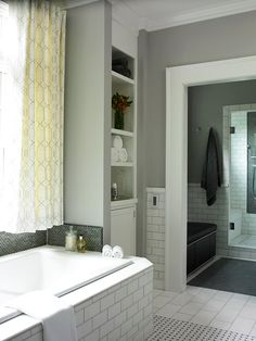 I love the Art Deco inspired look of this bathroom especially in the details like the curtains, floor and white piping on the bench.  I am a huge fan of contrast but although this area is monochromatic it has enough variety to make it work for me.  So cool!!!