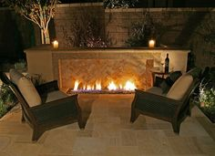 small gas outdoor fireplace....no chimney needed! Could be perfect ...