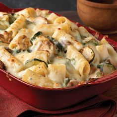 Creamy Zucchini & Spinach Rigatoni Recipe Main Dishes with rigatoni, oil, zucchini, fresh mushrooms, garlic, flour, crushed red pepper, basil dri leav, fat free reduced sodium chicken broth, Neufchâtel, baby spinach leaves, Kraft Grated Parmesan Cheese, shredded mozzarella cheese