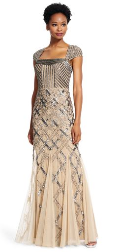 Buy for $338. A fully beaded gown is detailed with an envelope back and finished with cap sleeves.
