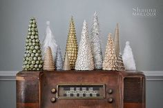 DIY Christmas Cone Trees- lots of good ideas with household materials! Love these!
