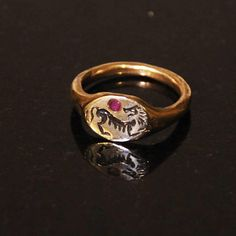 Hey, I found this really awesome Etsy listing at https://www.etsy.com/listing/596686707/lion-motif-ring-with-ruby-stone-bronze