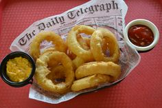 Craft Beer Battered Onion Rings: Thick-cut onions are dipped in Indeed Daytripper, a local craft beer, then battered, deep fried and served with a spicy beer mustard. @ Ball Park Café