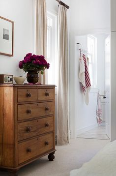 white walls, cream curtains... scrub back the chest of drawers and replace the handles...light, neutral