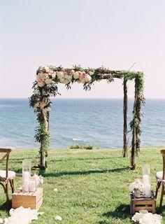hydrangeas and leafy on wedding arch