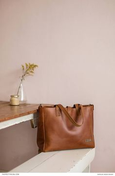 Leather baby nappy bag   Photo by Basque Imagery  