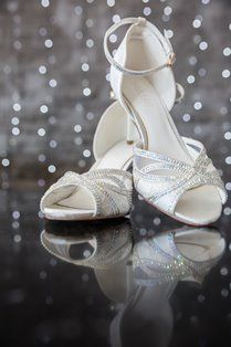Vintage inspired Lulu is made of white satin, delicate lace and see through gauze and is embellished with hundreds of Crystal trims. Lulu has a strong white resin heel that can be wiped clean, that measures to a height of Bridal Shoes, Wedding Shoes, Ballet Shoes, Dance Shoes, Socks And Heels, White Satin, On Your Wedding Day, Ankle Strap, Vintage Inspired
