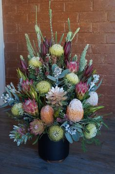 Large banksia display floral arrangement for a funeral. Flowers by RANE flowers.