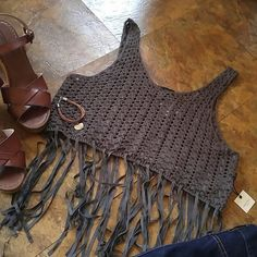 Nwt Boho knit fringed top New, never worn. Great for any boho look. Compliment any figure with this essential piece. Dark grey in color. 18 inches pit to pit, 15.5 in length. Dont miss out Forever 21 Tops Crop Tops