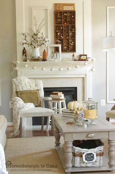 Family room dressed for Fall - White pumpkin garland, printers drawer, cotton branches.