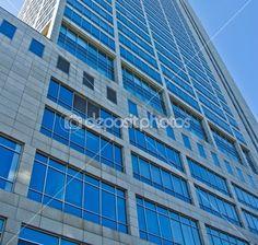 Modern Skyscraper Office Building, Windows and Blue Sky