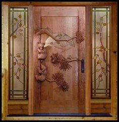 Sculpted door, love the bears and stained glass accents.  Uniquely interesting!