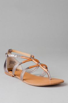 Live life- you guessed it- in the fast lane wearing this two-tone strap happy sandal.  Faux leather straps create a unique T-strap that is wrapped with an alternate color to add some pop.  Pair these bohemian sandals with a maxi dress or cutoff shorts for a fresh summer look.<br><br>  -Fabric upper <br>  -Distressing may vary by piece <br>  -                Measurements were taken using size 10 M and may vary by size<br>  - Adjustable buckle at ankle strap <br>  - By BC Footwear <br…