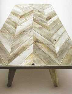 Reclaimed wood cladded into table tops back boards, and wall pieces.