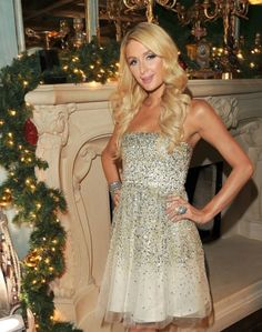 Welcome to my humble abode: Paris Hilton throws a massive Christmas party at her million house. but where are all the celebrities? Holly Madison, Hugh Hefner, Strapless Dress Formal, Formal Dresses, Paris Hilton, Luxury Lifestyle, Celebrities, Day, Christmas