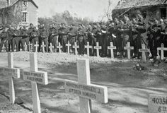 Dead being buried at Gold beach after (British) Gold beach landings 6 June 1944.