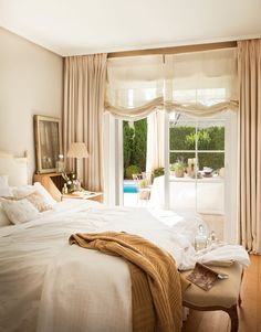 Restaurada con cariño · ElMueble.com · Majorca, Spain - Master Bedroom with French doors to the patio and pool