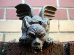 Gargoyles are usually an elongated fantastic animal because the length of the gargoyle determines how far water is thrown from the wall.