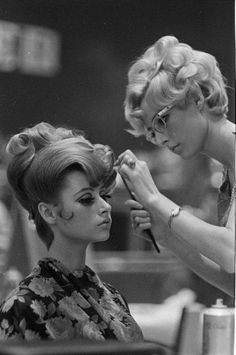 A young woman getting her hair done in the 60's.
