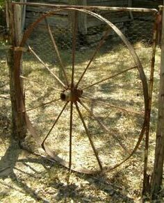 Old Wagon Wheel Iron Gate. Great for wall decor or conversation piece! Original white chippy paint too! www.ocalaantiques.com