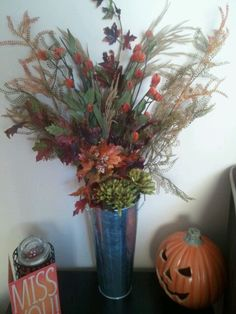Here is my lovely fall flower arrangement that I made!