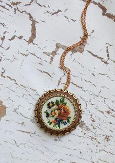 forgotten flowers indie necklace  $24.99  We are completely enchanted with this vintage inspired brass necklace, which features an embellished pendant and an antiqued floral design. Indie designed.