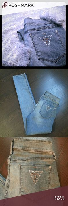 """GUESS skinnies Med wash, silver accents.  Inseam 30.5""""  Note: Super soft gray & white sweater (pictured) for sale in closet! Guess Jeans Skinny"""