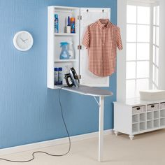 Ironing is no longer a chore with this wall-mounted ironing center. This ironing board and storage center keeps everything conveniently located in one space-saving area. You will have plenty of space