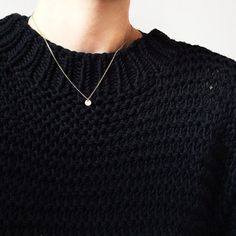 Delicate necklace on chunky sweater