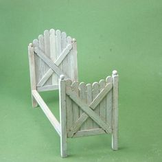 Make a dollhouse bed from wooden stir sticks