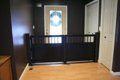 HEMNES dog gate - the headboard & footboard made into a stylish and functional pet gate for an opening that your average off-the-shelf pet gate won't fit. (And hey, it would probably work for a baby gate, too.