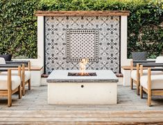 Outdoor living space in the backyard features a fire pit and a cement tile fountain. See the full Sacramento Spanish house DIY renovation project in the link. #firepit #exteriordesign #patiodesign #patiofurniture #patiodecor #fountain #outdoorliving #outdoorlights #diyremodel #remodel #sacramento