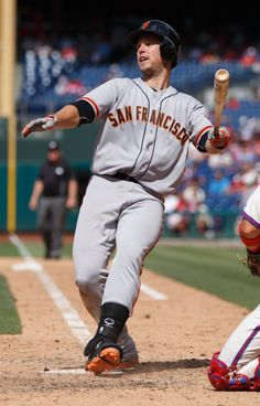 San Francisco Giants' Buster Posey loses his balance as he bats during the eighth inning of a baseball game against the Philadelphia Phillies, Thursday, July 24, 2014, in Philadelphia. (AP Photo/Chris Szagola)