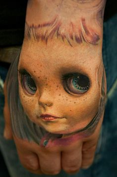 Creepy girl doll hand jammer realism tattoo - by Andy Engel