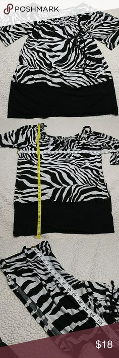 TORRID zebra print stretch blouse TORRID zebra print stretch blouse Cold shoulder sleeves  Please use measurements for guide since it no longer has the size tag on the blouse. Feel free to message me for details(: torrid Tops Blouses