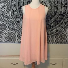 (A93) Peach Shift Dress Adorable 1920's vibe dress in a feminine peach color. Great condition, one tiny hole in the back but no issues anywhere else. No size marked but can fit a small-medium. ☆ Please ask any and all questions ☆ Measurements and modeling available ☆ Make me an offer! Dresses Mini