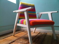 I like the whitewashed chair and the brightly coloured cushions.