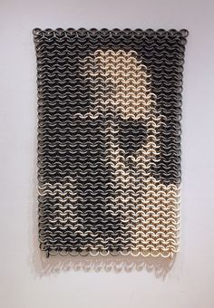 """Ruth Borgenicht """"I use the chain mail pattern and other woven patterns to create ceramic works that conjure up a sense of permanence and defensive concealment. Like the ancient armor, my pieces are made of a fabric of moveable interlocking rings. Using clay to make a protective mesh is contradictory; for how can it defend anything, much less itself? Visually stone-like, the pieces appear strong and impenetrable, belying their inherent fragility."""""""