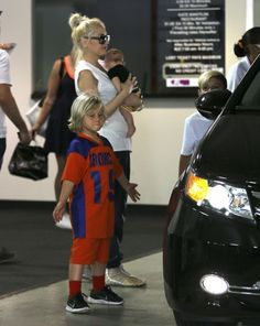 Singer Gwen Stefani and her nanny take her boys Kingston, Zuma and Apollo to Zuma's flag football game