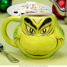 3D character mug sculpted and painted in the likeness The Grinch himself. This ceramic novelty drink cup makes a unique and colorful gift for children and fans. Microwave safe; hand washing recommended. Measures 6.5