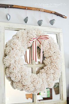 Pom Pom Wreath | Just Following Jesus.. not only do I love this wreath..but the stick with the metal hearts..I am thinking I may have 4 or 5 heart shape tea strainers that would work for this!! perfect!